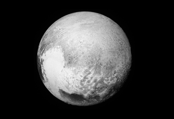 "A new map of Pluto's 'heart.' This image released on October 29, 2015, provides fascinating new details to help the science team map the informally named Krun Macula (the prominent dark spot at the bottom of the image) and the complex terrain east and northeast of Pluto's ""heart"" (Tombaugh Regio). Pluto's north pole is on the planet's disk at the 12 o'clock position of this image. Credit: NASA/Johns Hopkins University Applied Physics Laboratory/Southwest Research Institute"