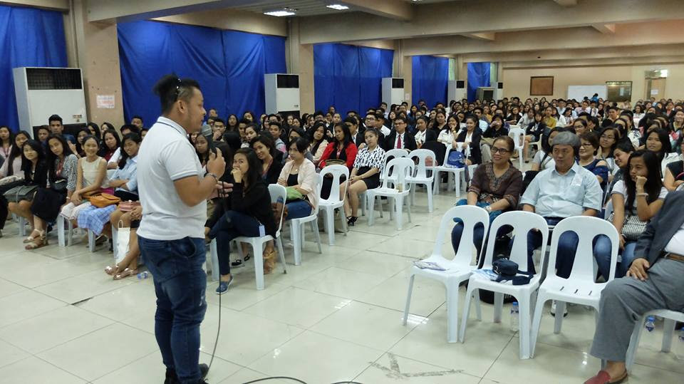 Filipino motivational speaker shares the stage with his scholar Kelvin