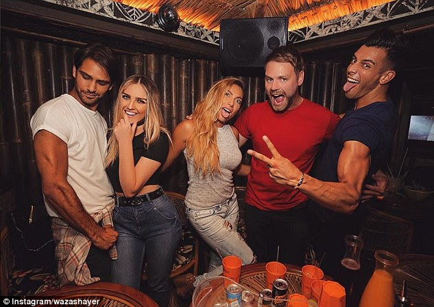 Divas: Perrie Edwards (second left) is pictured in Mahiki with Luke Pasquiano (left)