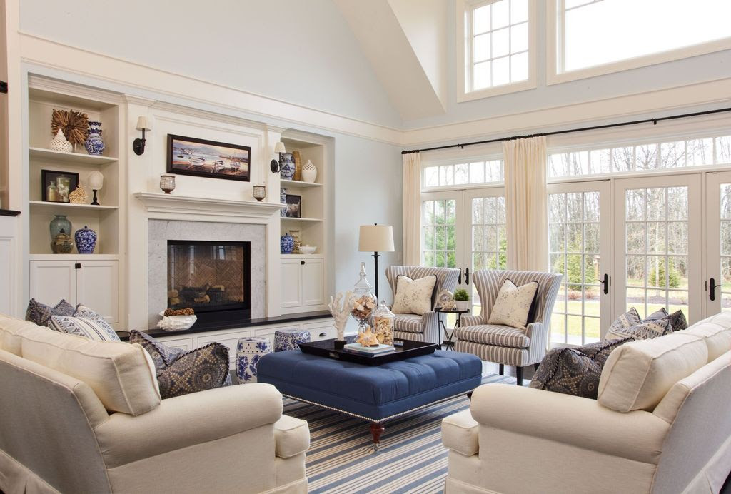 Traditional Living Room with Cement fireplace, Z Gallerie Tufted Ottoman - Sapphire, Wall sconce, French doors, Crown molding