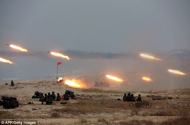 Live fire: This undated picture from the North Korean Central News Agency shows rockets being fired by the DPRK army. The US says it can protect South Korea from ballistic missiles