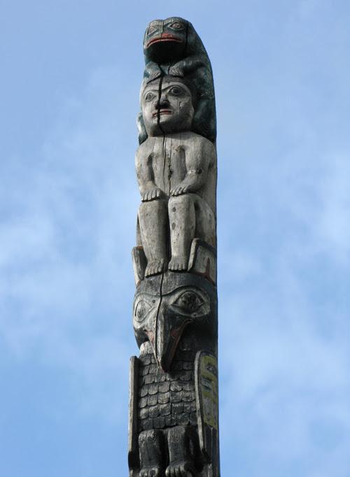 the top figures of a totem pole, downtown Juneau, Alaska