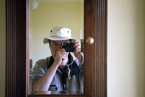 reflected self-portrait with Agfa Optima 535 camera and light weight hat by pho-Tony
