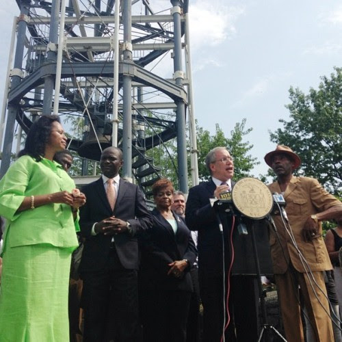 Marcus Garvey Park's Fire Watchtower Preservation  My office announced a $1 million allocation yesterday that will complete the preservation of the historic Fire Watchtower in Harlem's Marcus Garvey Park—the last such 19th century structure standing in New York City. This allocation was the final financial piece needed to finish a restoration project that began in the early 90's. Without the funding provided today and the restoration work to follow, we were in danger of losing a significant part of Harlem's history I'm proud that a structure which had been abandoned and fenced off will once again become a beautiful and vibrant part of this public park. I'm also proud to have worked with the Marcus Garvey Park Alliance and the Mount Morris Community Improvement Association to have made this possible.   This 47-foot, cast iron tower has been watching over Harlem since 1857 and was designed as a lookout post for fire volunteers, who would climb the stairs, look out for fires and ring a 10,000-pound bell in the event of a blaze. Even as the fire department modernized, replacing towers with telegraphic alarms, the tower played a role in the community, with the bell sounding during the week and on Sundays for timekeeping and church purposes. The tower is a designated New York City landmark and is also listed on the National Register of Historic Places.