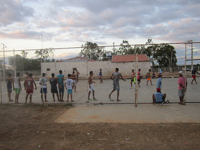 Youngsters play on the football pitch built with income from the electricity generated between 2014 and 2016 in the two social housing complexes in the municipality of Juazeiro, in northeastern Brazil. They used to have a sports coach, as well as computer courses, dental care and other activities, but the suspension of the project forced them to stop providing these services. Credit: Mario Osava/IPS