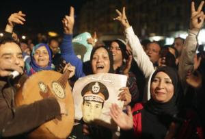 People celebrate after Egypt's army chief Field Marshal Abdel Fattah al-Sisi declared his candidacy for a presidential election,  in Cairo