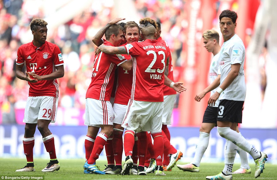 Mario Gotze (C) is mobbed by his team-mates after he scored their third goal and his second of the afternoon on Saturday