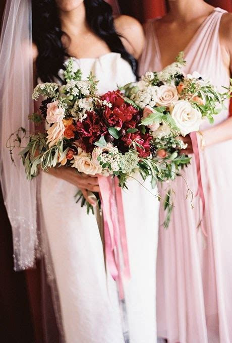 A Fall Bouquet of Red and White Ranunculus, Poppies, Roses