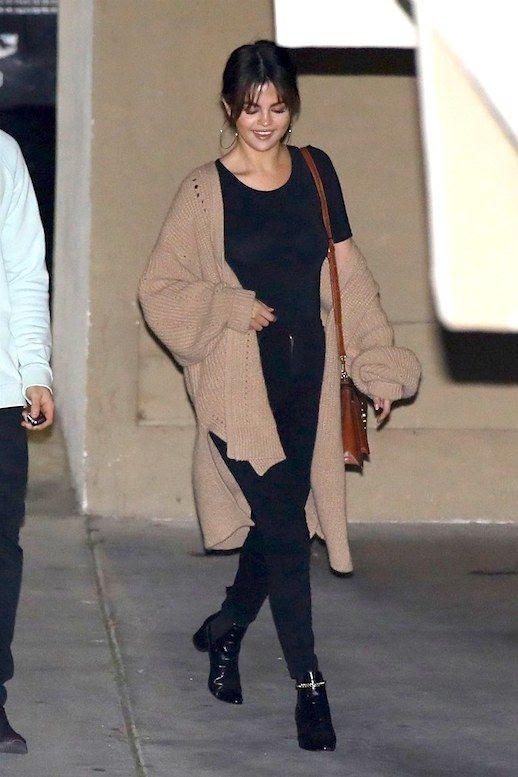 Le  Fashion  Blog  Selena  Gomez  Casual  90's  Gold  Hoops  Black  Crew  Neck  T  Shirt  Camel  Cardigan  Coat  Black  Skinny  Jeans  Black  Heeled  Boots  Via  Vogue