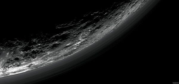 An image of Pluto taken by NASA's New Horizons spacecraft on July 14, 2015...showing haze layers above the dwarf planet.