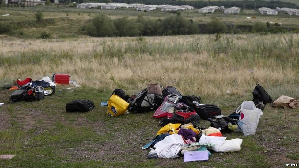 Luggage and belongings are seen near the site of Thursday's Malaysia Airlines Boeing 777 plane crash