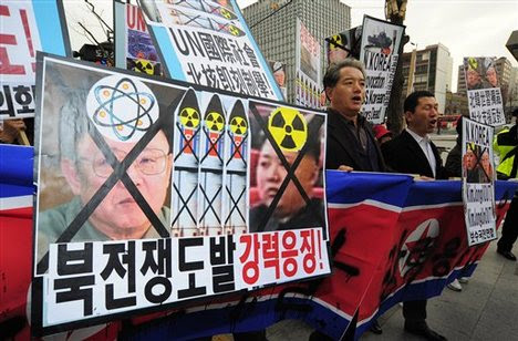 north korean women marching. Protesters march during a