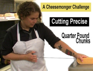 Jana Werner cutting a precise quarter pound of cheese