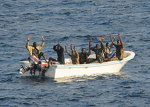 Suspected pirates keep their hands in the air ...