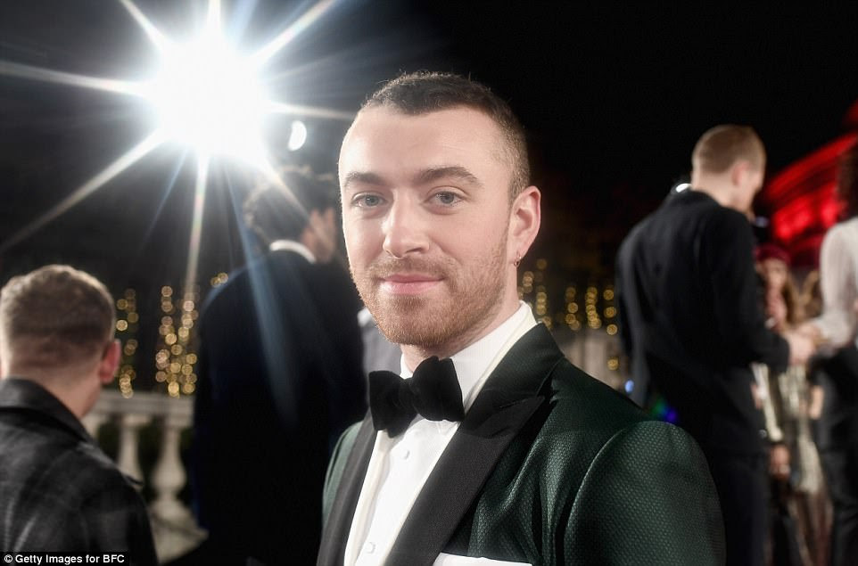 Dapper gent: The chart-topping singer cut a dapper figure in a textured green tuxedo, teamed with a crisp white shirt