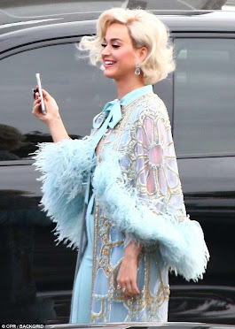 Katy Perry oozes old Hollywood glamour in a feather wrap and blonde wig as she arrives on American Idol set