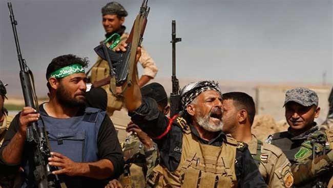 Combattants des Unités de mobilisation populaire (Hach al-Chaabi)