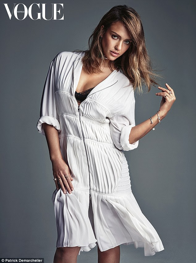 Sultry: In another photo, the Sin City actress is swathed in a loose-fitting pleated tunic by Christian Dior, worth $7,300