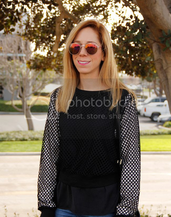Los Angeles fashion blogger The Key To Chic wears the sports luxe trend with a Target mesh top, Zara skinny jeans, and Peter Pilotto for Target geometric print sneakers.