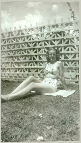 girl on grass with two piece bathing suit
