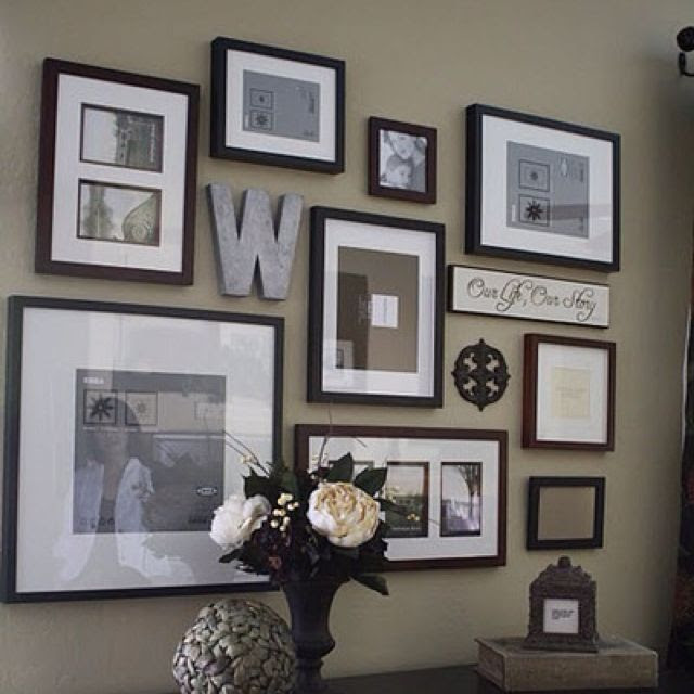 @Kathryn Kimmons Barrios  This is kind of like what we have on the floor right now lol   Picture Frame Wall Collage