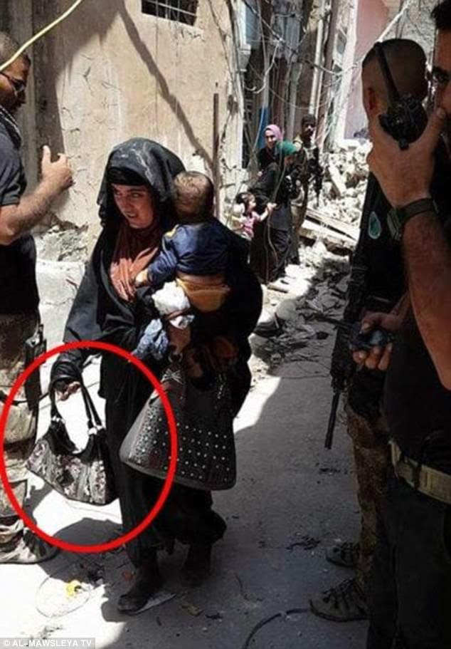 The picture was taken moments before the suicide bomber blew herself up, with her baby in her arms