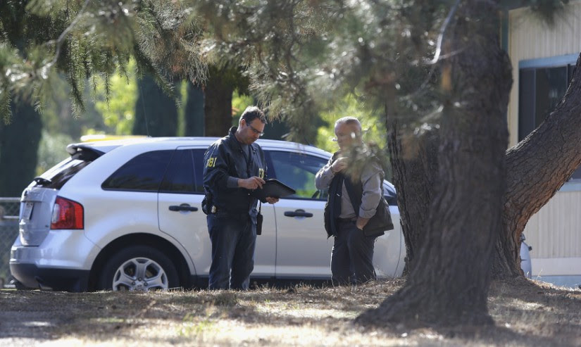 Law enforcement officers at an elem   entary school in Rancho Tehama Reserve, where a gunman opened fire. AP