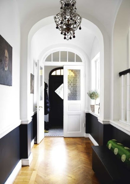 black and white narrow hall with parquet flooring