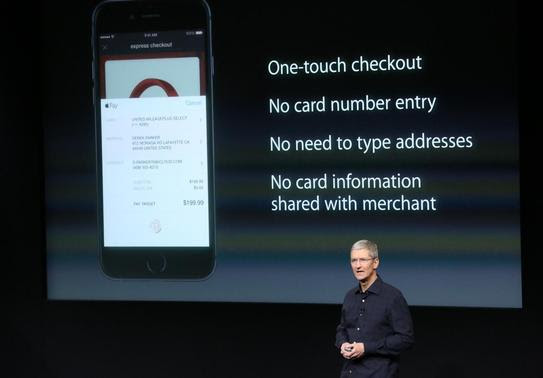Apple CEO Tim Cook speaks about the Apple Pay service during a presentation at Apple headquarters in Cupertino, California October 16, 2014.  REUTERS-Robert Galbraith