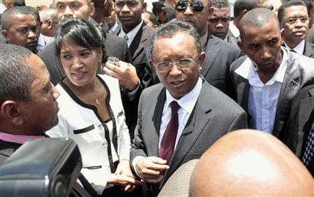 Hery Rajaonarimampianina (C) is congratulated after he was declared Madagascar's president-elect by the electoral court in Antananarivo January 17, 2014. REUTERS/John Friedrich Rabenandro