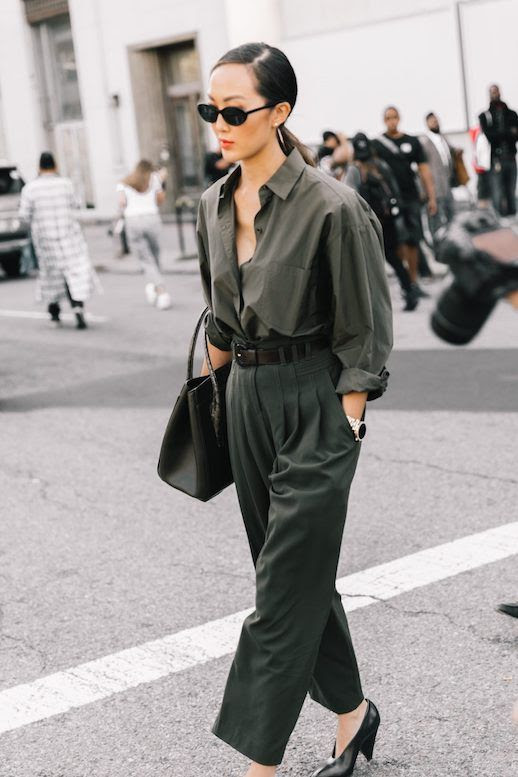 Le Fashion Blog NYFW Chriselle Lim Blogger Streetstyle Sunglasses Olive Green Button Down Black Belt Olive High Waisted Pants Black Heels Via Collage Vintage