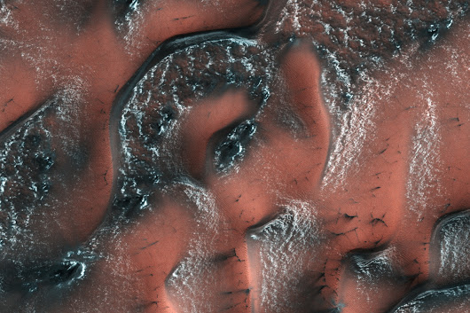 NASA releases delightful photo of snowy dunes on Mars