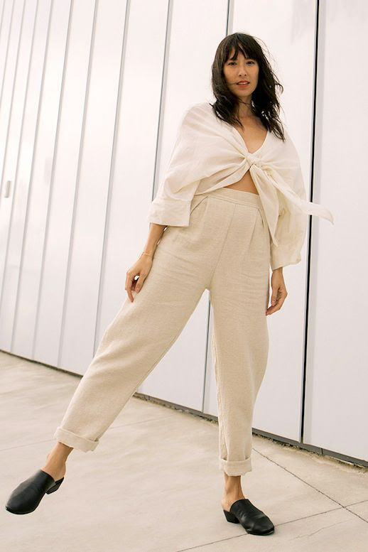 Le Fashion Blog Summer Street Style Neutrals Knotted Linen Top High Waisted Trousers Black Slip On Mule Flats Via Elizabeth Suzann