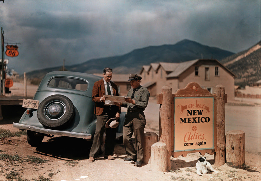A tourist stops to get directions from a cop in New Mexico.Photograph by Luis Marden, National Geographic