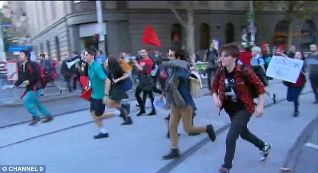 Stampede: Student protesters take hold of the Melbourne streets on Wednesday
