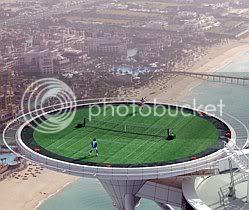 Roger Federer and Andre Agassi play tennis on Burj Al Arab Hotel helipad