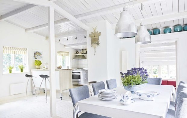 White dining room and kitchen in a summer cottage