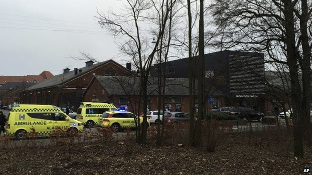 "Emergency services gather outside a venue after shots were fired where an event titled ""Art, blasphemy and the freedom of expression"" was being held in Copenhagen, Saturday, Feb. 14, 2015"