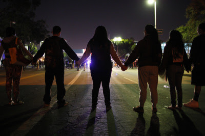 Protestors face police in Los Angeles following the grand jury announcement. (David McNew/Getty Images)