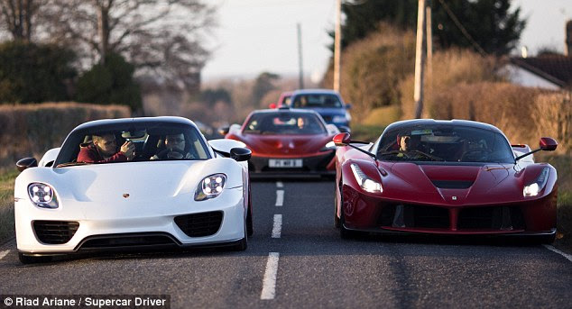 'Holy Trinity': Paul Bailey drives his white Porsche 918 (left) while his wife Selena drives his Ferrari LaFerrari (right) with a friend in his McLaren P1 behind. The cars have a combined worth of more than £3million