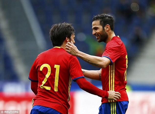 Premier League stars Silva and Fabregas celebrate after the latter doubled the lead with a fine effort