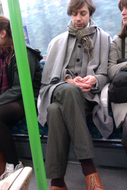 Sherlock Holmes look-a-like on the Tube by Annie Mole