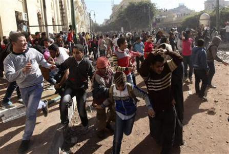 Egyptians flee the security forces after clashes over the role of the military. After the parliamentary elections in Egypt people continue to protest military rule. by Pan-African News Wire File Photos