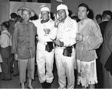 "Four big names of Hollywood get together on the set at Shepperton, England, Aug. 4, 1961, during a break in filming scenes of a new movie. From left are: Bing Crosby, Frank Sinatra, Dean Martin and Bob Hope. Crosby and Hope are in Chinese costume for the film, ""Road To Hong Kong.""  Sinatra and Martin, en route to a Riviera vacation, are dressed as spacemen for their roles in the Hope-Crosby picture. (AP Photo)"