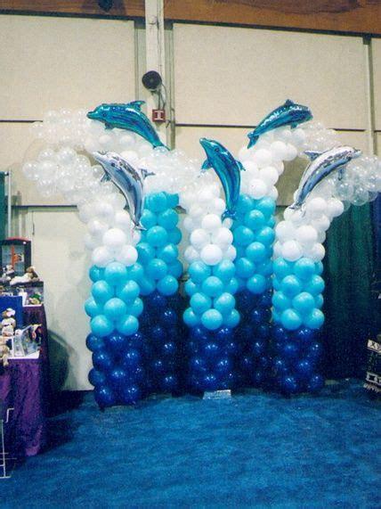 ocean colored balloon columns  dolphins  top