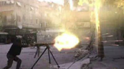 Yarmouk, uma vez que um bairro próspero, tem sido fortemente devastada depois de ser sitiada por forças do governo há mais de um ano [AFP]