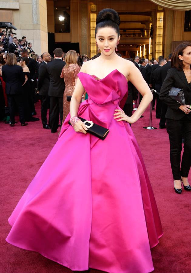 Fan BingBing added a much-needed flash of colour in a fuchsia ballgown with an asymmetric neckline ©Getty