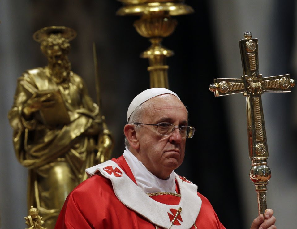 Pope Francis holds the pastoral staff after he bestowed the Pallium, a woolen shawl symbolizing their bond to the pope, to 35 Archbishops, during a mass in St. Peter's Basilica, at the Vatican, Saturday, June 29, 2013. (AP Photo/Gregorio Borgia)