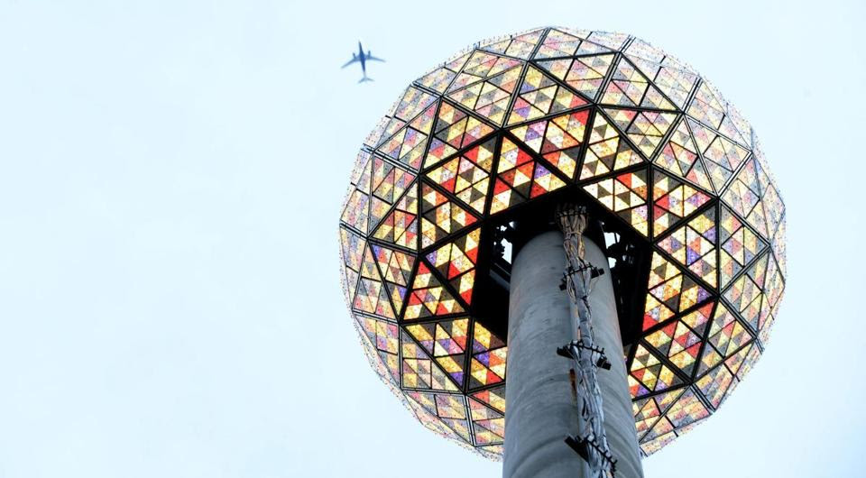 The lighting was tested Tuesday on the New Year's Eve ball to be dropped in the Times Square celebration in New York City. The tradition has inspired drops of an opossum, a cowboy boot, and a pine cone across the country. (EPA/JUSTIN LANE)