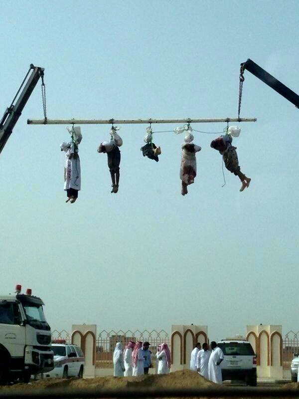 The 'crucifixion' of 5 beheaded bodies in Saudi Arabia.
